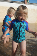 toddler twins playing at beach wearing HappieCo