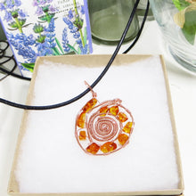 Amber and Copper Sunburst Pendant Necklace on Black Cotton Cord