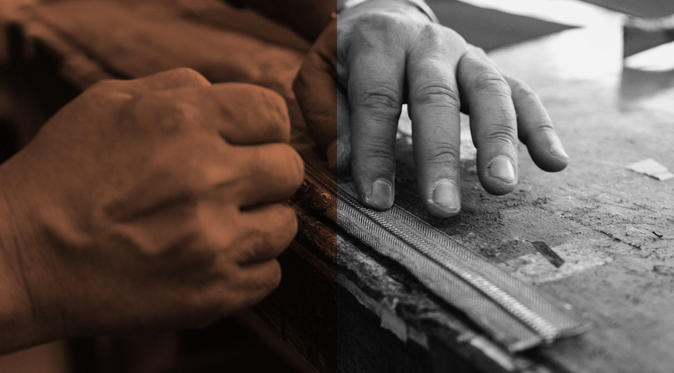 Photo of man working on leather