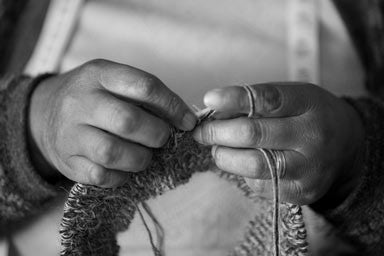 Hands of an artisan knitting ethical fashion