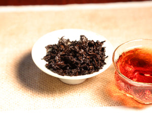 Yi Tribal Coins Tube Fermented Puer Tea - Wild Tea Qi Official Website