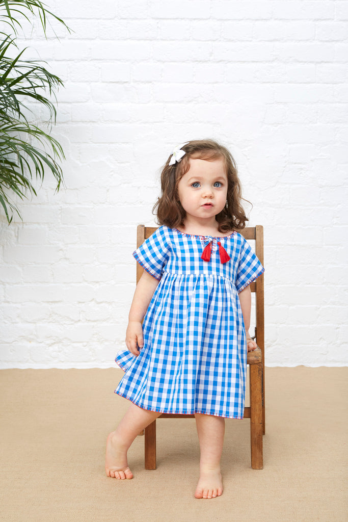 LITTLE TASSLE DRESS - BLUE GINGHAM