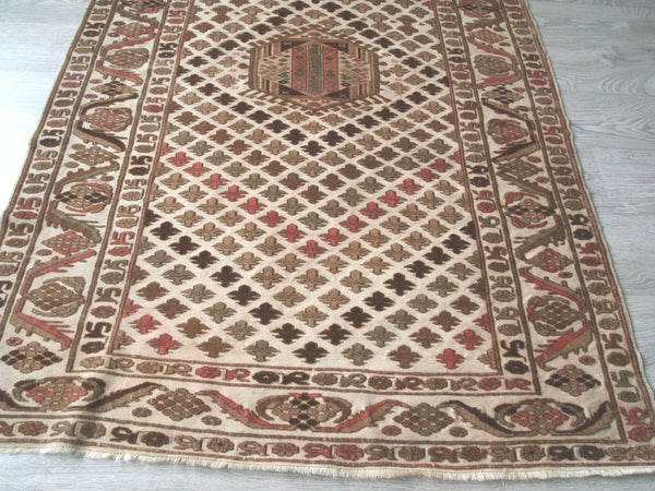 Vintage Turkish Rug. Area Rug. Olive, brown, pink. Long view.