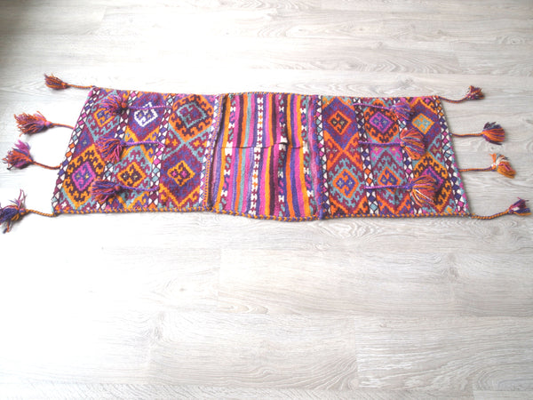 Full view of 100% wool vintage turkish rug or saddlebag.