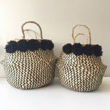 Seagrass baskets from Kit + Loom. Zigzag pattern with black yarn pom poms.