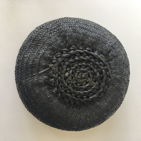 View of botton of seagrass belly basket - noir. Handwoven.