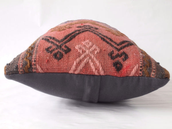 Side view of turkish kilim pillow. Hand cut from kilim rug.