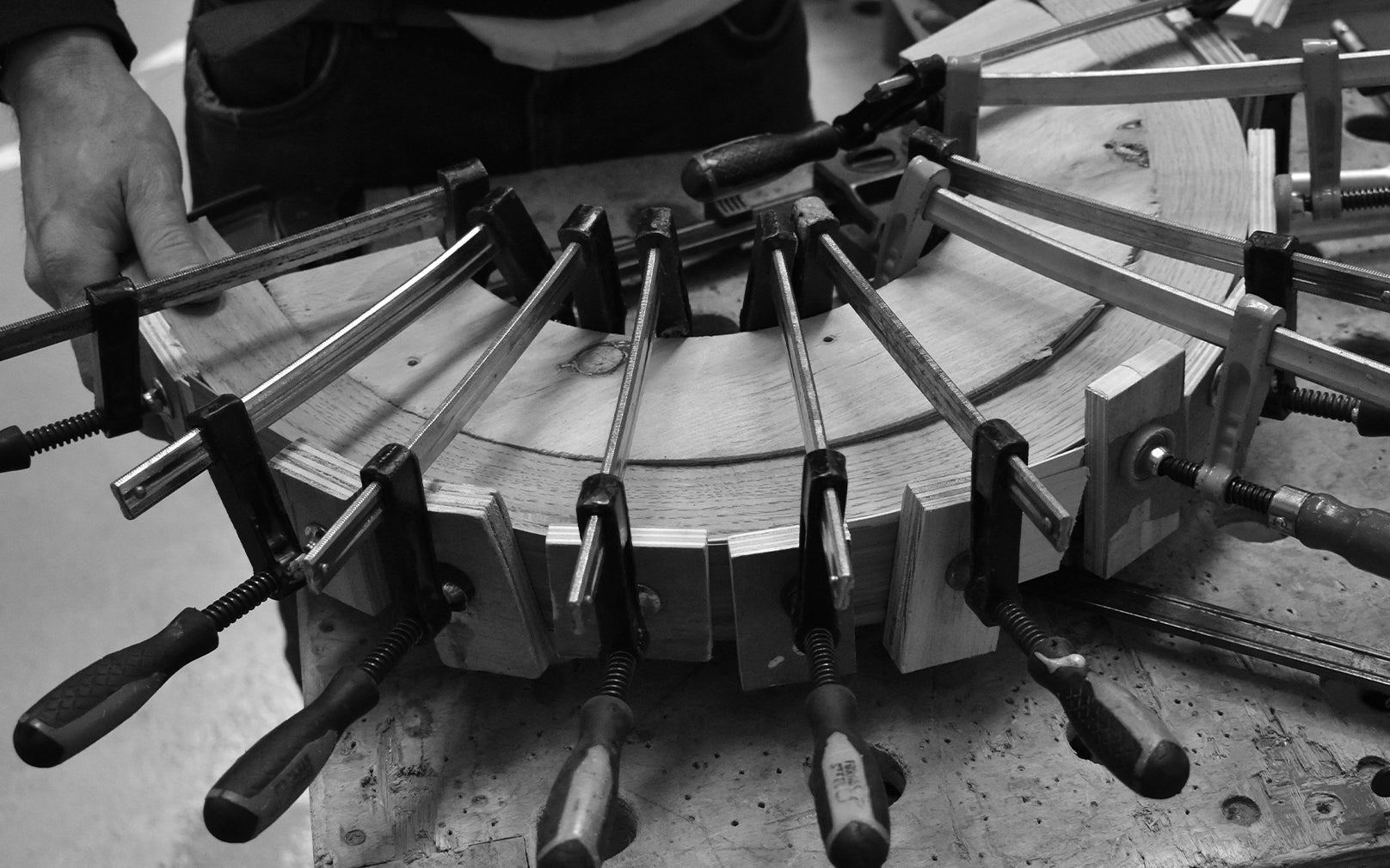 Clamps holding steam bent wood in place