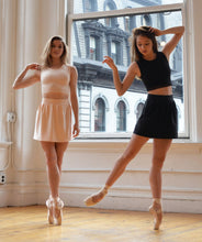 cropped tank pleated skirt ballet pointe shoes