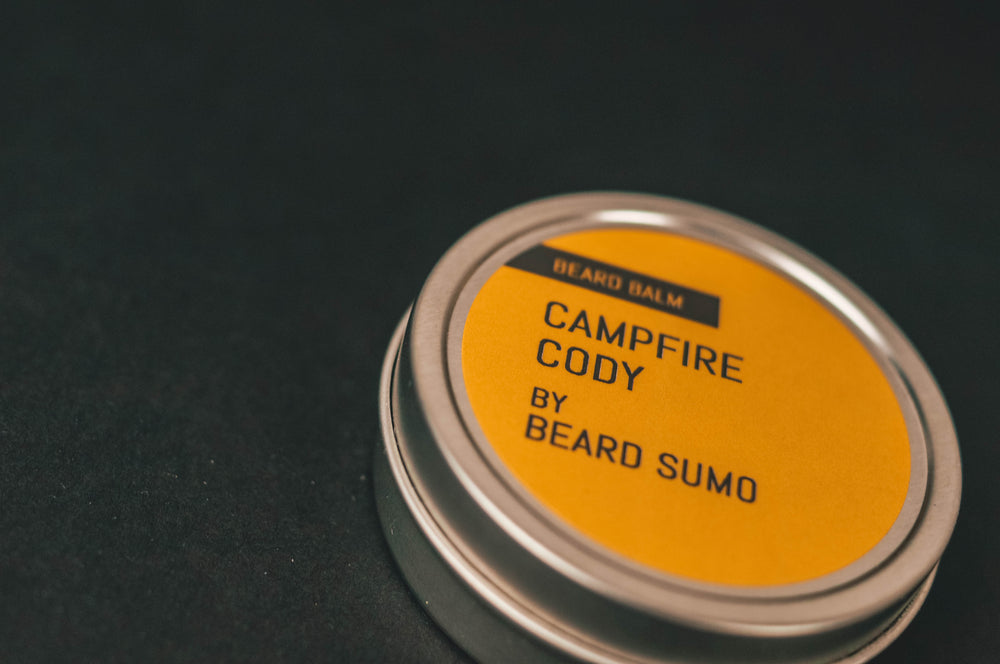 Close up glamour shot of Campfire Cody beard balm on black background