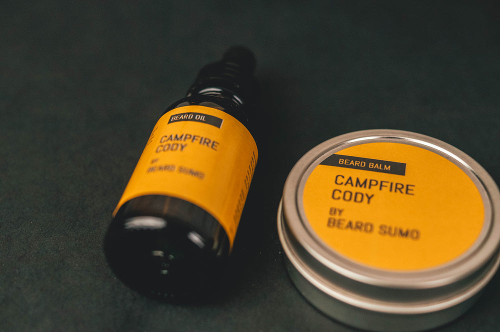 Campfire Cody beard balm canister beside Campfire Cody beard oil on black background