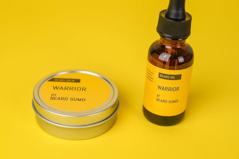 Warrior scented beard balm and beard oil, yellow background close up