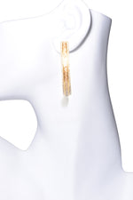 gold diamond hoop earrings on mannequin