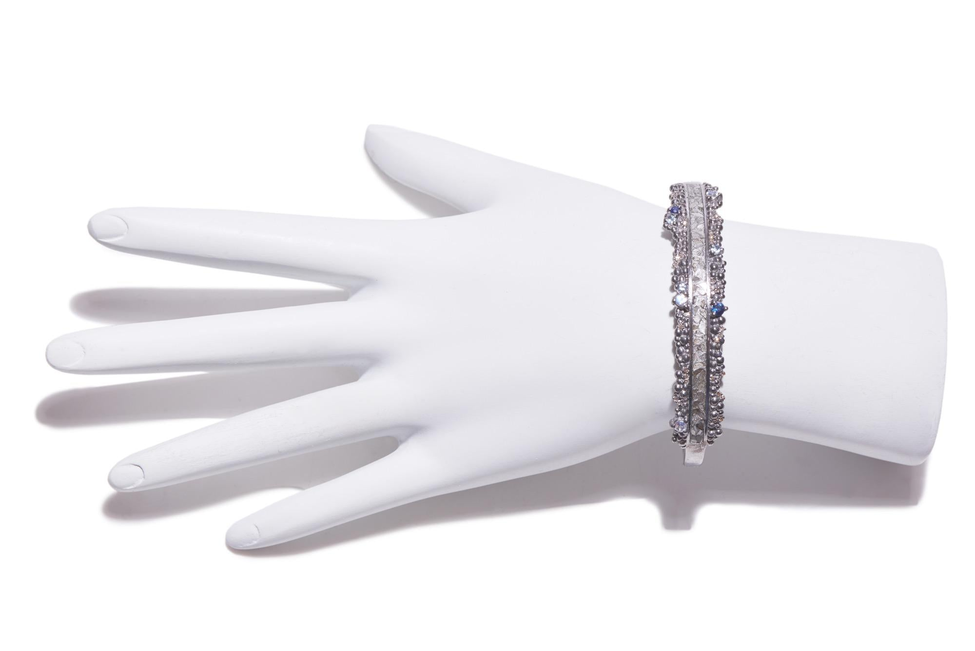 raw uncut sterling silver diamond bangle on mannequin