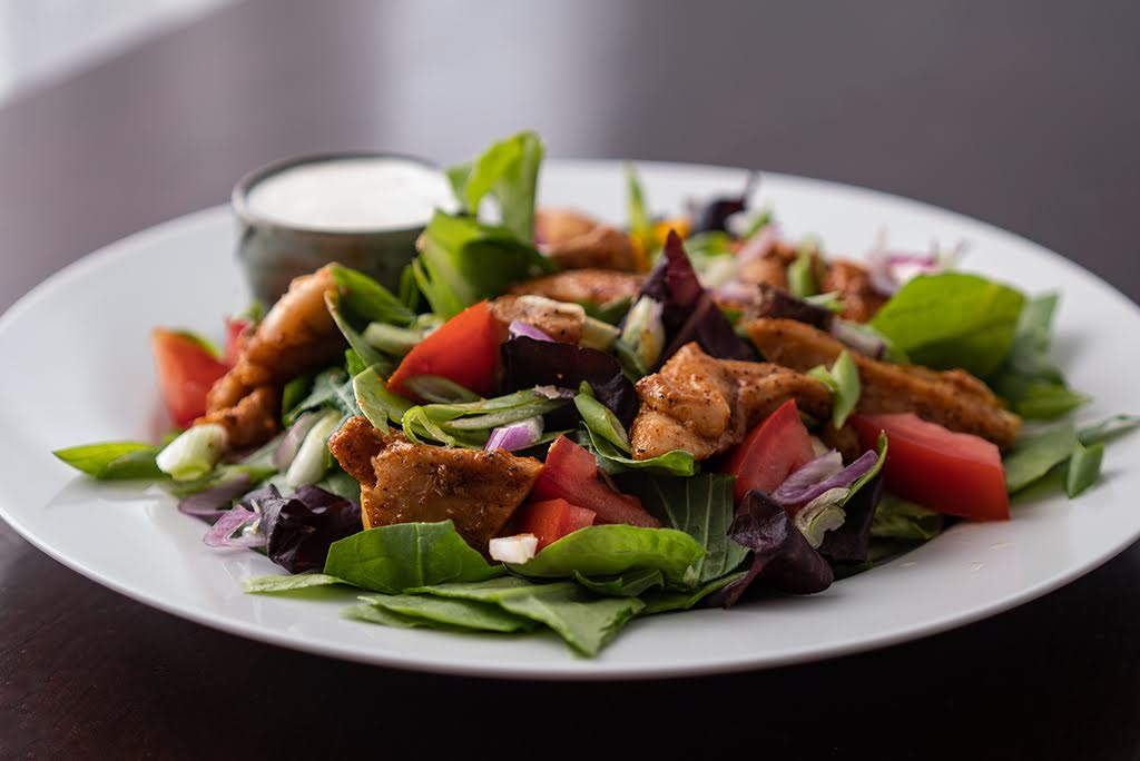 Creole Chicken Over Spring Mix with Blue Cheese Dressing