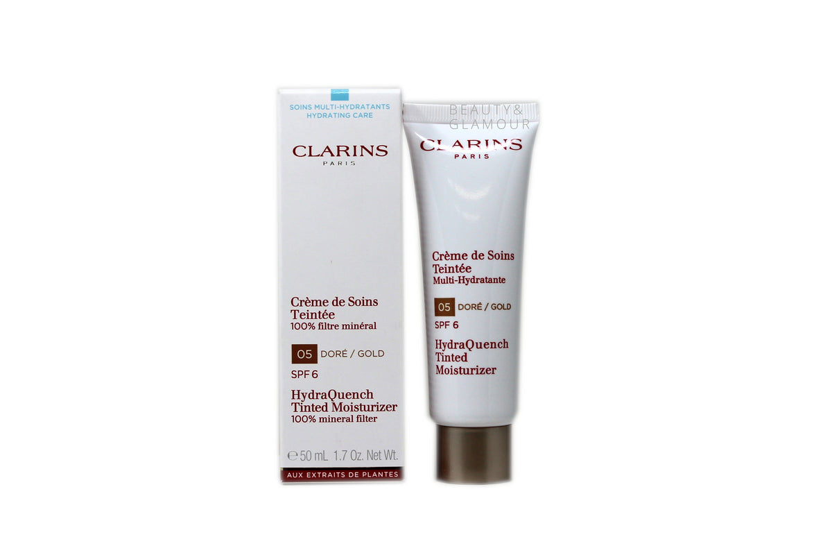 CLARINS HYDRAQUENCH TINTED MOISTURIZER  100% MINERAL FILTER  SPF 6  AVAILABLE SIZE: 50 ML/1.7 OZ.   SHADE: 5 - DORE