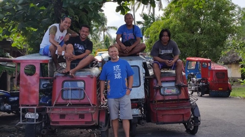 Bicol communities and Jason Thomas, CEO and Founder of Pili Hunters