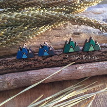 Green and blue wooden landscape earrings for comparison
