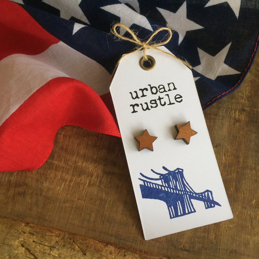 Wooden star stud earrings on American flag