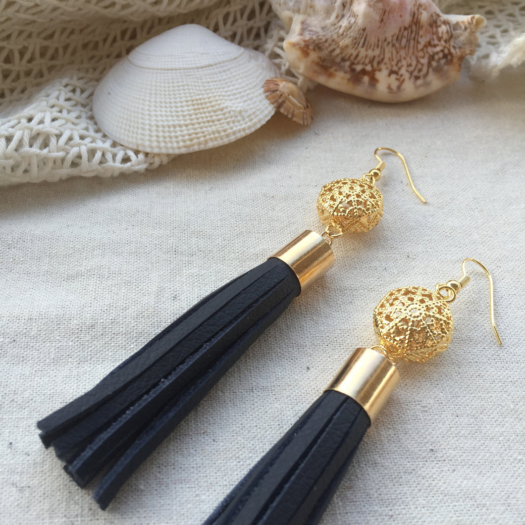 Navy leather tassel earrings with gold filigree charm