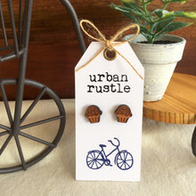 Wooden cupcake stud earrings on white card with hipster bike