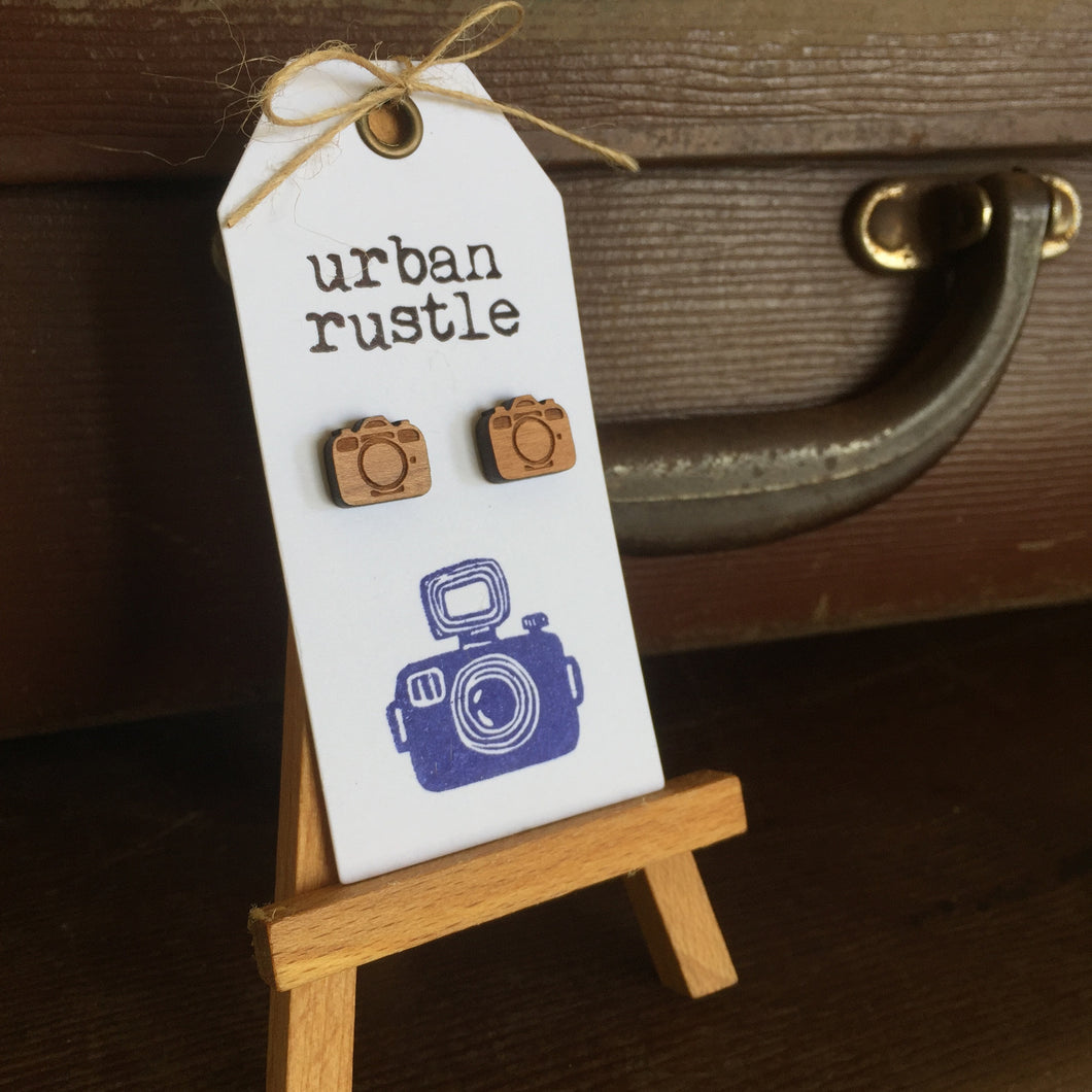 Vintage wooden camera earrings on white card