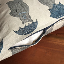 Blue bear with umbrella animal print cushion cover on rustic wood