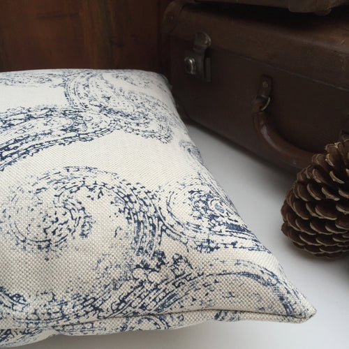 Antique china blue and white cushion with vintage suitcase