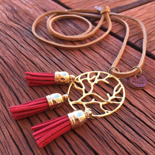 Red tassel on gold tree-of-life charm necklace