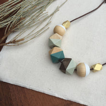 Light green gold wooden geometric necklace with cotton cord