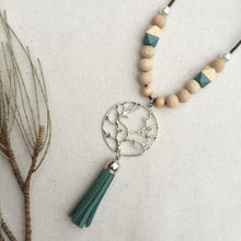 Wooden beaded cotton cord necklace with green tassel
