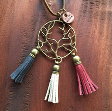 Blue, white and red flag leather tassel necklace with antique bronze charm