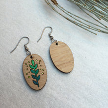 Green plant wooden drop earrings front and back view