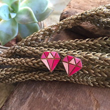 Pink diamond wooden earrings in the wild
