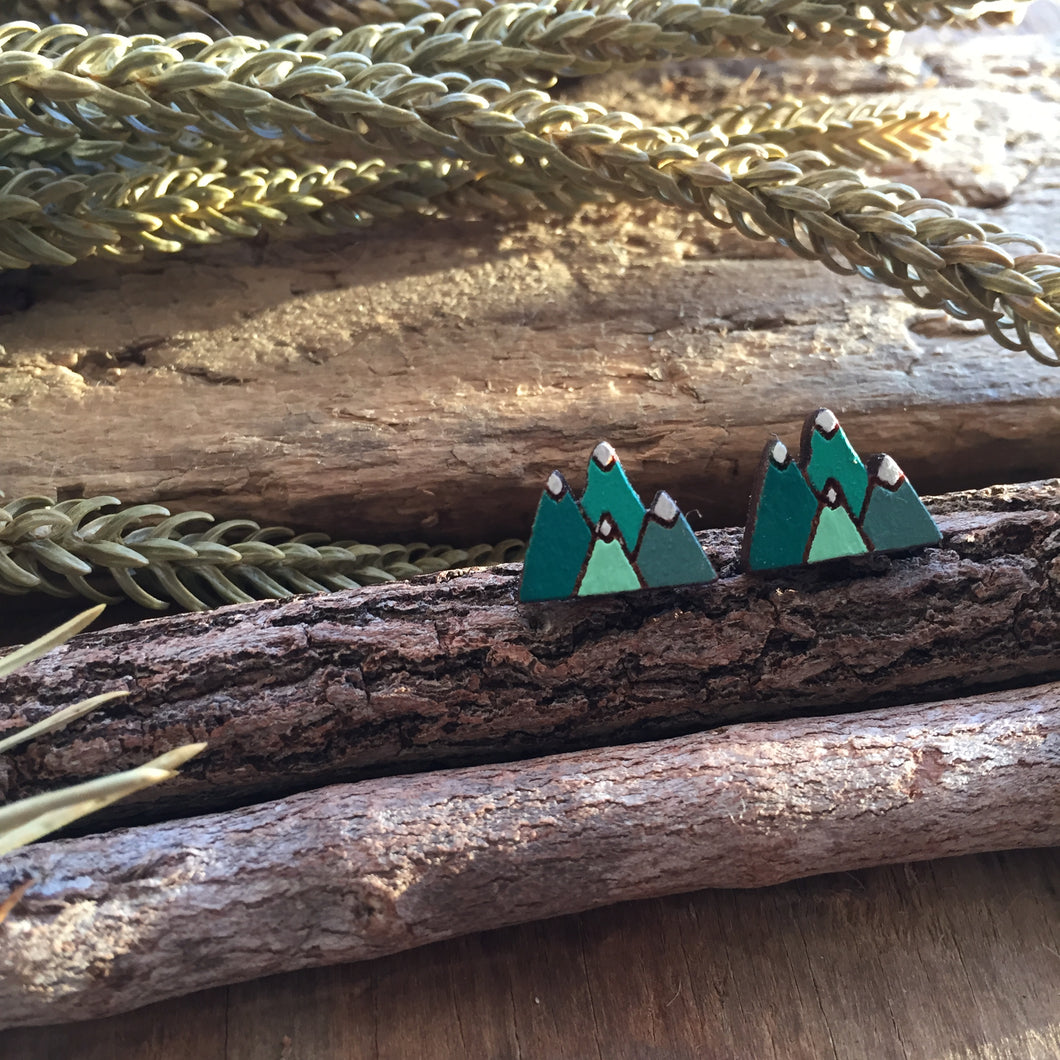 Green mountain landscape wooden stud earrings in the wild