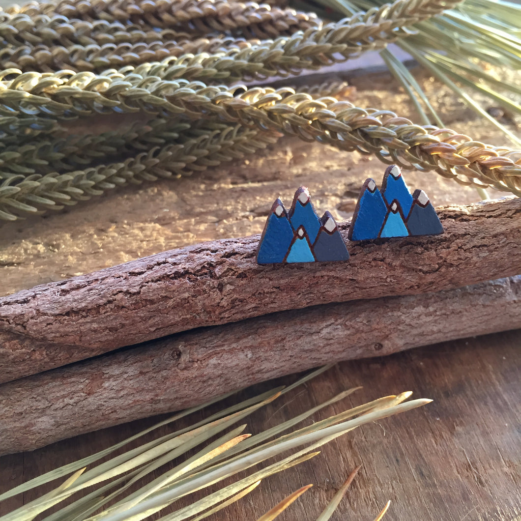 Blue mountain wooden stud earrings in the wild