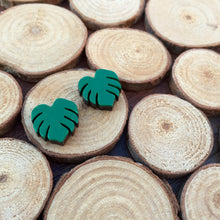 Monstera leaf earrings on wood chips
