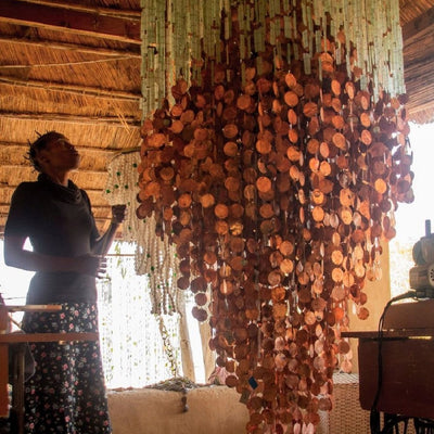ALM News | Malawi Tumbled Glass Chandeliers