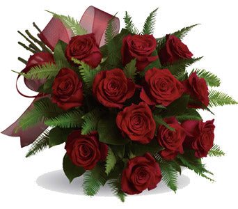 12 Red roses in Hand tied bouquet