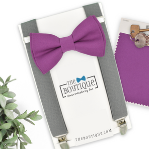 purple bow tie and grey suspenders