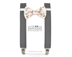 blush bow tie and gray suspenders