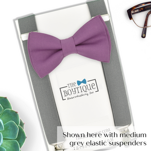 dark mauve bow tie and grey suspenders