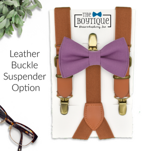 purple bow tie and leather suspenders