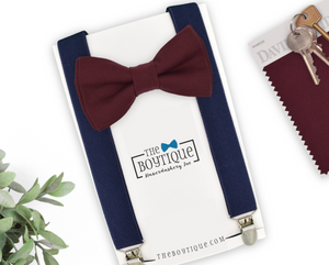 wine bow tie and navy suspenders