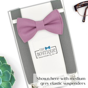 mauve bow tie and grey suspenders