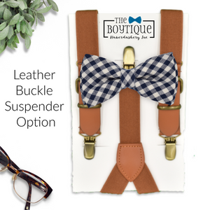 dark blue bow tie and leather suspenders