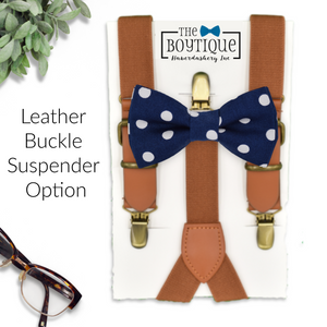 navy bow tie and leather suspenders