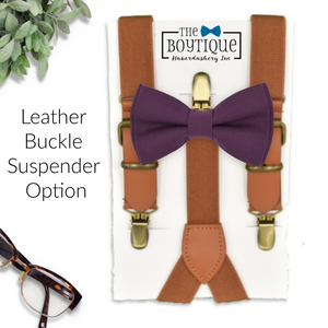 plum bow tie and leather suspenders