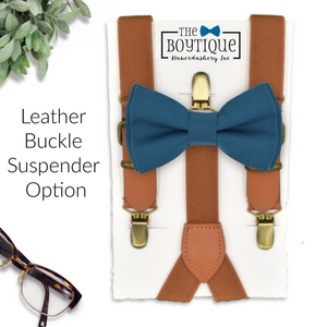 teal bow tie and leather suspenders