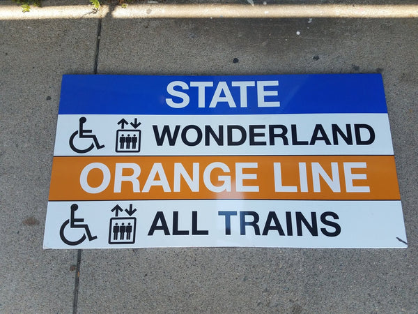 Blue and Orange Line Elevator Sign from State Station